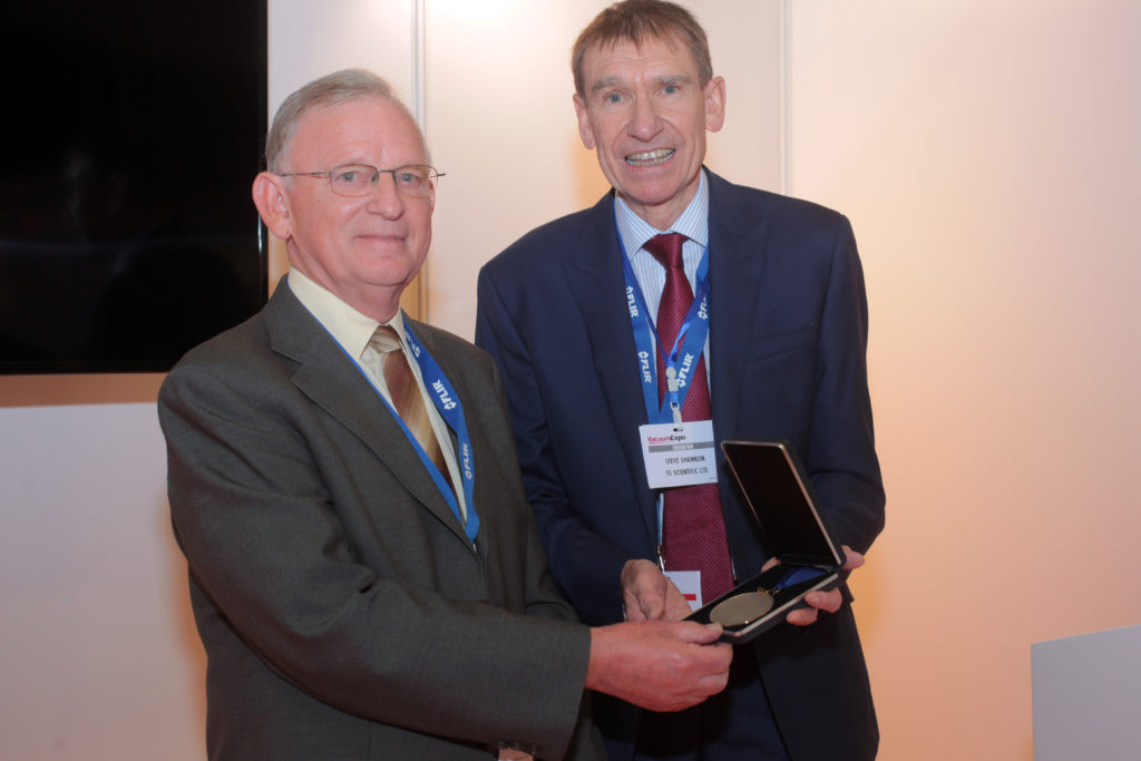 Ron (left) receiving the award from Steve Shannon representing the VS Committee